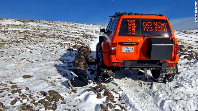 Tour guide Kiddi lets air out of the tires for better traction on slippery banks of ice and snow.