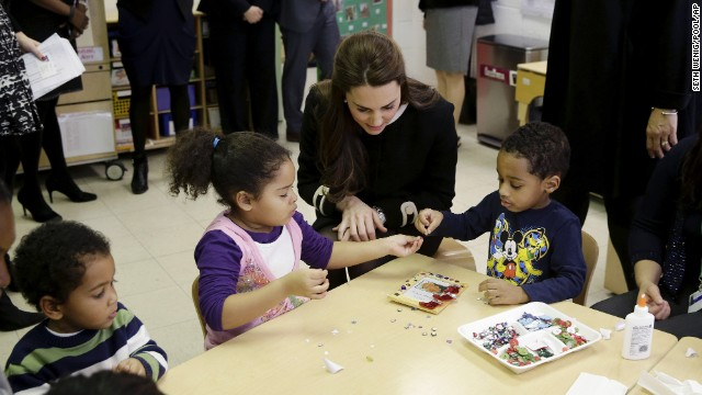 Kate sits next to children December 8 during a preschool class at the Northside Center for Childhood Development in New York.