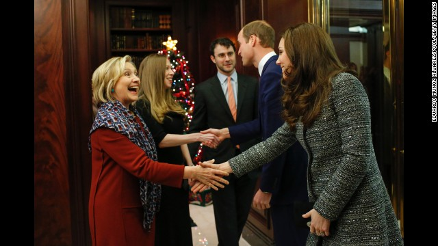 Hillary Clinton, Chelsea Clinton and Chelsea Clinton's husband, Marc Mezvinsky, greet the royal couple at the reception on December 8.