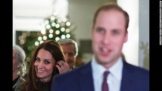 The duchess smiles while she listens to Prince William talk to guests December 8 at a reception in New York co-hosted by the Royal Foundation and the Clinton Foundation.