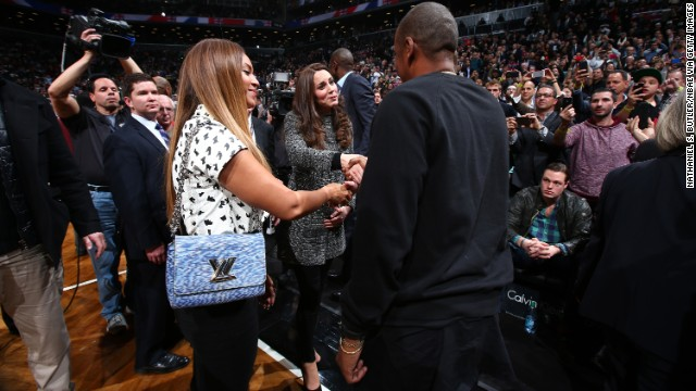 Beyonce and Jay-Z talk with the royal couple after the game.