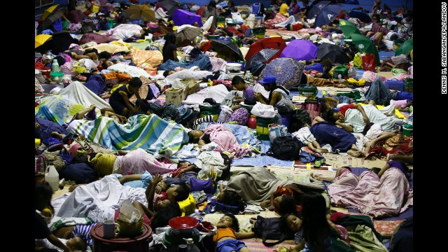 People seek refuge inside a temporary evacuation center in Quezon City, Philippines, on Tuesday, December 9. Typhoon Hagupit tore apart homes and sent waves crashing through coastal communities across the eastern Philippines.