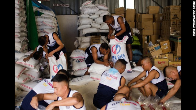 Philippine navy personnel pack rice packages at a government distribution center in Manila, Philippines, on December 8.