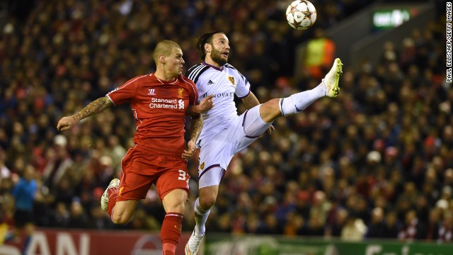 Shkelzen Gashi of Basel and Martin Skrtel of Liverpool endured a fierce contest with both sides desperate to make it through to the knockout phase.