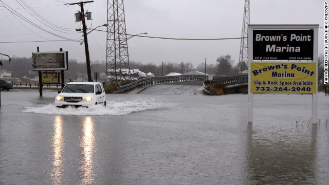 An SUV braves a flooded street in Keyport, New Jersey, on December 9.