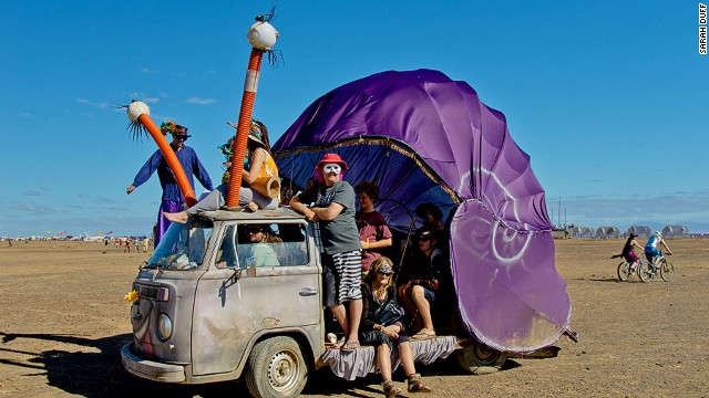Many people bring bicycles to get around the huge festival site. Others arrive in weird customized vehicles like this this big, purple snail.
