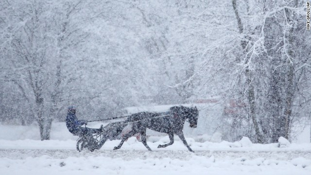 A horse and driver train on a harness track on December 11 in Saratoga Springs, New York.