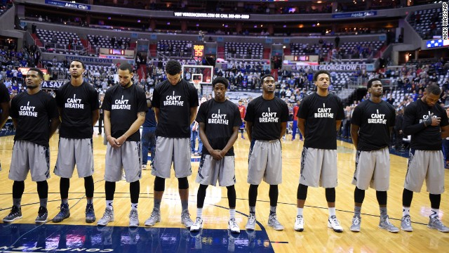 "Members of the Georgetown basketball team wear ""I can't breathe"" shirts as they stand for the national anthem before a home game Wednesday, December 10, in Washington. The shirt references the words spoken by Eric Garner, a 43-year-old man who died earlier this year after being put in a chokehold by a New York City police officer. After a grand jury decided not to bring criminal charges against the officer, demonstrators across the country took to the streets to express their outrage."