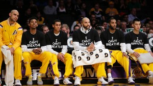 Los Angeles Lakers\' Nick Young, Jordan Clarkson, Carlos Boozer, Wayne Ellington and Jeremy Lin protest during a game against the Sacramento Kings on December 9 in Los Angeles.