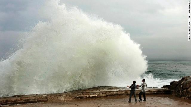 Waves break December 10 on Ocean View Boulevard in Pacific Grove, California.
