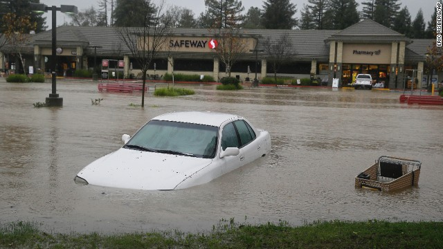 A car is submerged at a flooded shopping center in Healdsburg, California, on December 11.