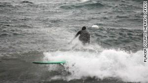 A surfer rides Lake Tahoe.