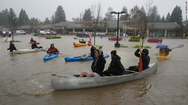 <strong>December 11:</strong> People use kayaks and a canoe to make their way around a flooded shopping center parking lot in Healdsburg, California. What seemed a godsend of rain has <a href='http://www.cnn.com/2014/12/10/us/gallery/storms-batter-coasts/index.html'>pummeled the drought-ravaged state</a> with flood warnings in wine country, a potential winter storm in the Sierras and enough moisture to cause mass urban blackouts.