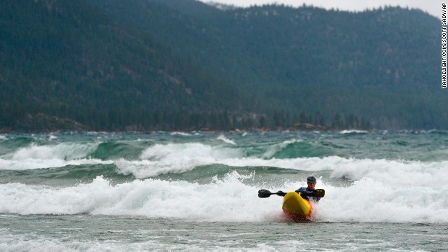 Pete DeLosa paddles his kayak through tall waves on Lake Tahoe, kicked up by a strong storm moving across California and Nevada on December 11.
