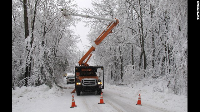 Green Mountain Power cuts limbs overhanging power lines in Waterbury, Vermont, on December 11.