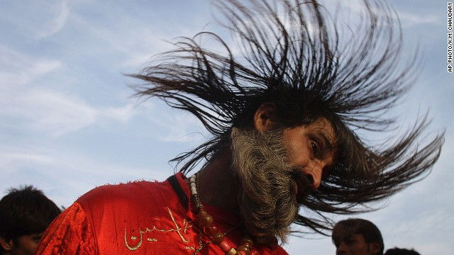 DECEMBER 12 - LAHORE, PAKISTAN: A Muslim devotee dances to celebrate the three-day annual congregation of famous saint Data Ganj Baksh at a shrine. Thousands of people traveled from all over the country to attend the celebrations.