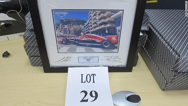 A signed photo of Jules Bianchi driving in the Monaco Grand Prix lends a poignant note to the auction. The French racer claimed the team's first points in Monaco this season but remains in hospital with severe head injuries after a crash at the Japanese Grand Prix in October.