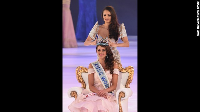 Miss World 2013 Megan Young crowns Strauss during the finale of the pageant.