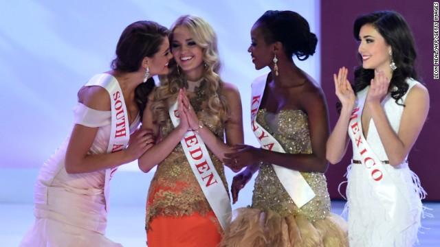 Strauss, Miss Kenya Idah Nguma and Miss Mexico Daniela Alvarez Reyes congratulate Miss Sweden Olivia Asplund on winning the swimwear fashion section of the pageant.