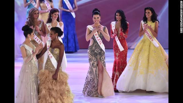 Miss Brazil Julia Gama, center, reacts after being announced as a quarterfinalist.