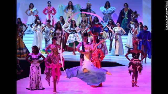 Miss Finland Krista Haapalainen, center, dances with a ribbon.