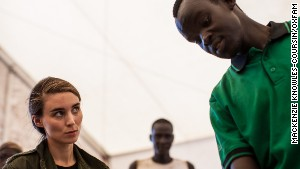 Rooney Mara listens as an Oxfam worker explains food distribution in South Sudan.