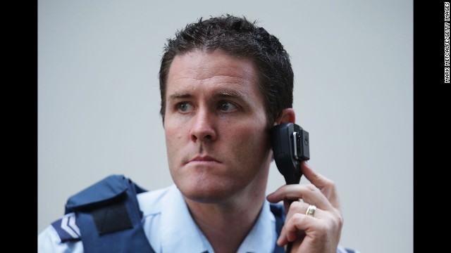 A police officer listens to a radio on December 15.