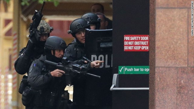 Armed police are seen outside the cafe on December 15.