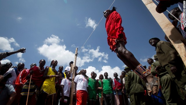 DECEMBER 15 - SIDAI OLENG WILDLIFE SANCTUARY, KENYA: A Maasai warrior competes in the high jump, in which athletes must touch a fixed line with the top of their heads, at the annual <a href='http://cnn.com/2014/12/05/africa/gallery/maasai-olympics/'>Maasai Olympics</a> near Mount Kilimanjaro. Maasai men and women from the Amboseli and Tsavo region compete for medals and prizes in the event which aims to replace lion hunting as the traditional warrior activity.