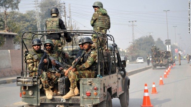 Pakistani troops reach the site of the attack on December 16.