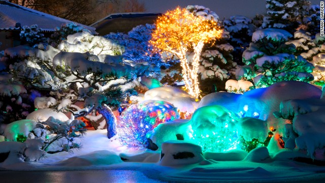 Walking through Denver Botanic Gardens, visitors see thousands of lights on trees and plants. A pair of Holospex turn the lights into 3D candy canes, snowflakes and other shapes.