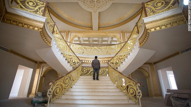 DECEMBER 16 - IRBIL, IRAQ: A construction worker walks up the staircase inside a $20 million replica of the White House being built inside Dream City. The exclusive residential suburb is one of several<a href='http://cnn.com/2014/01/07/business/can-black-gold-fuel-luxury-iraqi/'> high value areas developed in the Kurdish capital </a>since 2003, complete with their own mosque, shopping areas and schools.