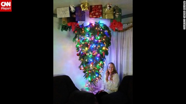 <a href='http://ireport.cnn.com/docs/DOC-1196629'>Sherri Aguilar</a> attaches her inverted Christmas tree to the ceiling with eye bolts and uses a staple gun to put up the gift bags and presents.
