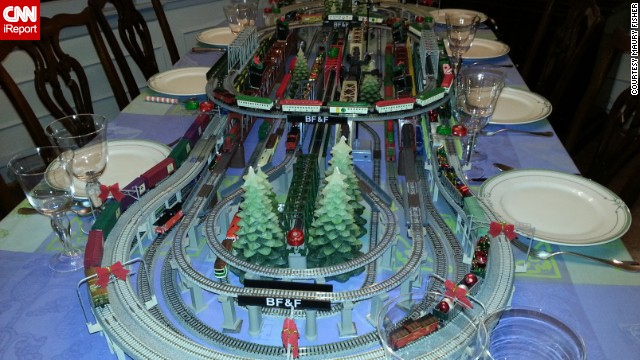Every Christmas Eve, Maury Fisher unveils a new model train display on the dinner table to delight his grandchildren.