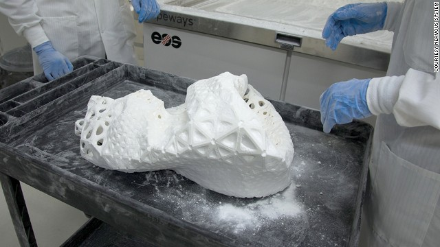 Technicians excavate the dress hidden in the mass of plastic.