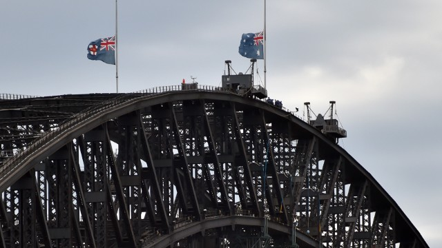 Australian flags fly at half mast on Sydney Harbour Bridge on December 16 following the fatal siege.