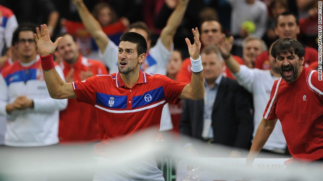 Djokovic celebrates after a historic win against Gael Monfils at the Davis Cup tennis match finals between Serbia and France in December 2010.