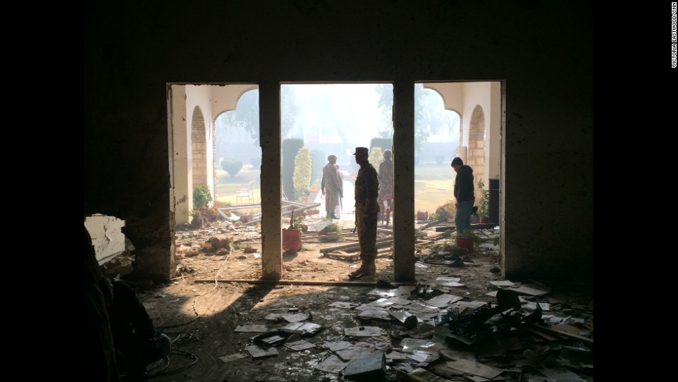 PESHAWAR, PAKISTAN: Pakistani policemen conduct an investigation at the site of the Taliban attack at the army-run school in Peshawar. The terrorist attack on Tuesday killed 148 people, mainly children. CNN's Nic Robertson & team goes inside the school that Taliban militants attacked. <a href='http://edition.cnn.com/video/data/2.0/video/us/2014/12/18/newday-robertson-inside-peshawar-pakistan-school.cnn.html'> WATCH ON CNN.COM</a>. <!-- --> </br>Photo by CNN's Victoria Eastwood. Follow Victoria (<a href='http://instagram.com/veastwoodcnn' target='_blank'>@veastwoodcnn</a>) and other CNNers along on Instagram at <a href='http://instagram.com/cnn' target='_blank'>instagram.com/cnn</a>.