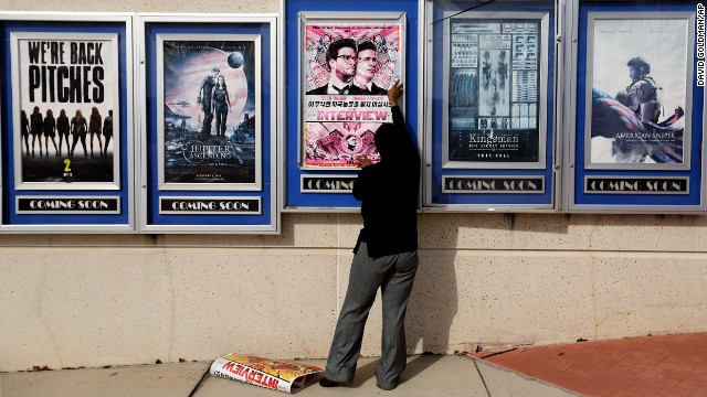 "<strong>December 17:</strong> A poster for the movie ""The Interview"" is taken down from a theater in Atlanta. Sony Pictures <a href='http://money.cnn.com/2014/12/17/media/the-interview-sony-theater-owners/index.html' target='_blank'>canceled its plans to release the comedy</a> -- which depicts an assassination plot against North Korean leader Kim Jong Un -- following a threat from a group that hacked the movie studio. FBI investigators tracked the hackers back to the North Korean regime, U.S. law enforcement officials said."