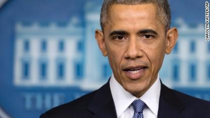 Upbeat Obama bids goodbye to tough year