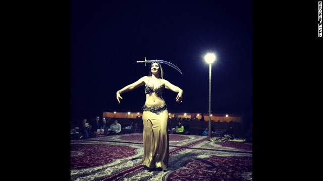 "UNITED ARAB EMIRATES: ""Belly dancer lights up the dark desert night in Abu Dhabi."" - CNN's Steven Jiang, December 20. <a href='http://instagram.com/p/w3lmMCmc3E/?modal=true' target='_blank'>WATCH THE INSTAGRAM VIDEO</a>. Follow Steven (<a href='http://instagram.com/stevencnn' target='_blank'>@stevencnn</a>) and other CNNers along on the new 'Scenes from the field' gallery on Instagram at <a href='http://instagram.com/cnnscenes' target='_blank'>instagram.com/cnnscenes</a>."