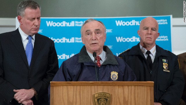 New York Police Department Commissioner Bill Bratton speaks alongside Mayor Bill de Blasio, left, and NYPD's Chief of Department James O'Neill, right, during a news conference at Woodhull Medical Center on December 20.