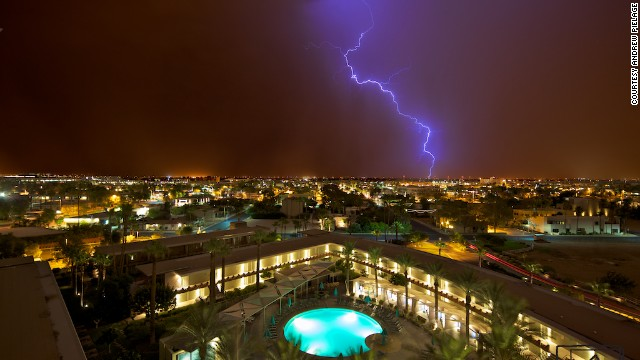 Monsoon season in the American Southwest comes with extreme heat, crackling thunder and booming lightning. Photographer <a href='http://ireport.cnn.com/docs/DOC-814216'>Andrew Pielage</a> captured this shot at exactly midnight in Scottsdale, Arizona, on July 12, 2012.
