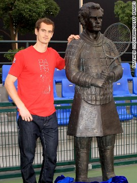 Andy Murray poses with a statue which is supposed to depict the tennis star as a Terracotta Warrior during the Shanghai Masters in 2011.