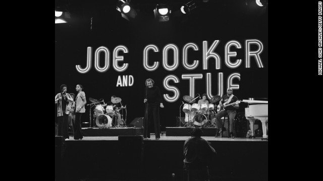 "Cocker, seen here in 1970, was known for flailing his arms onstage as he sang. John Belushi once parodied him on ""Saturday Night Live."""