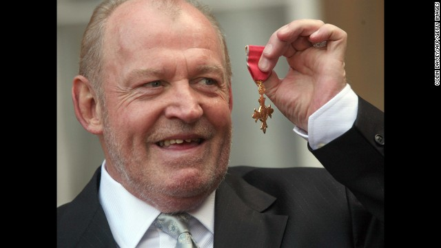 Cocker is pictured outside Buckingham Palace in 2007 after collecting his MBE (Member of the Order of the British Empire) for services to music.