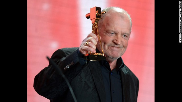 Cocker reacts after receiving a lifetime achievement award during the 48th Golden Camera awards ceremony in Berlin on February 2, 2013.