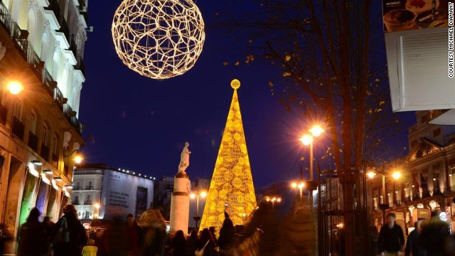 Bright Christmas decor adorns Puerto del Sol, a bustling square in <a href='http://ireport.cnn.com/docs/DOC-1069767'>Madrid, Spain</a>.