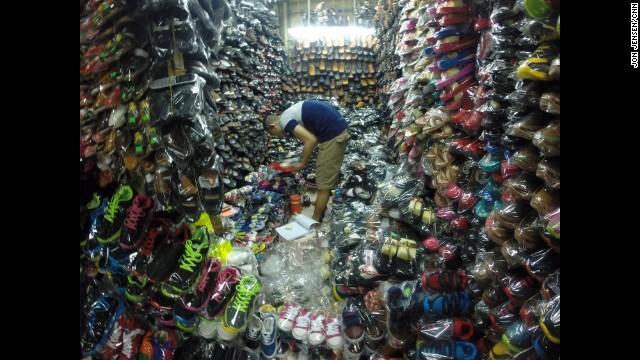 "VIETNAM: ""Hundreds and hundreds of shoes. Vendor in the alleys of Binh Tay Market in Ho Chi Minh City."" - CNN's Jon Jensen, December 23. Follow Jon (@jonjensencnn) and other CNNers along on Instagram at instagram.com/cnn."
