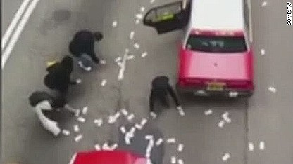Millions spill from security van